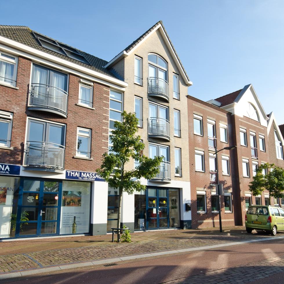 5 Appartementen en winkels Dorpsstraat 31/33 te Castricum